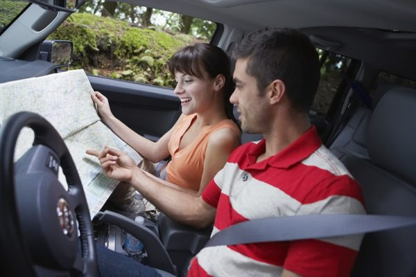 Life Journey Time Capsule - Couple in Car Looking at Map