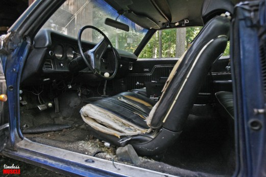 Though the driver's side seat is FAR worse than what's left on the passenger side, there simply was no repairing or saving the original vinyl.