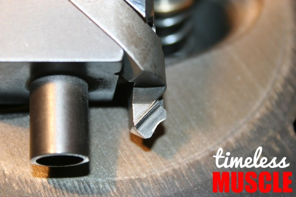 This is what the cutter looks like when removed from the tooling. You can see each distinct cutting angle on the blade. The large tube to the left uses the valve guide as an alignment point to perfectly center the cutter in each valve seat.