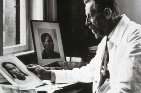 Eugen Fischer examining photographs