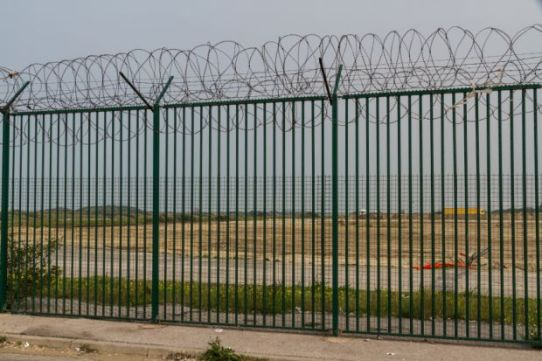 Fence with razor wire guarding French ferry terminal