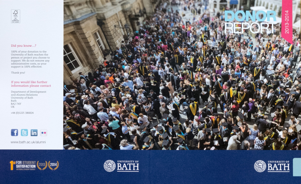 High-perspective view of hundreds of graduates and their families gathered outside Bath Abbey after graduation.