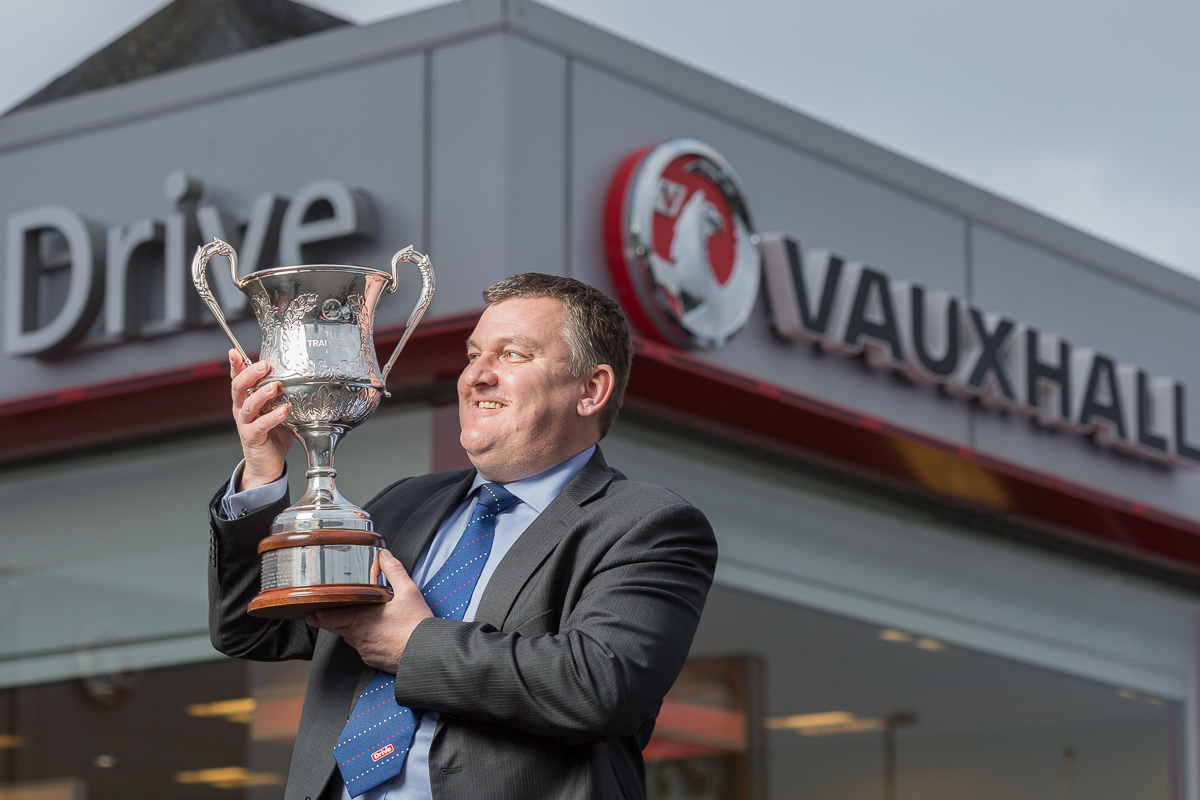 Steve Baynes, parts operation manager at Vauxhall Drive, Bristol, holds aloft the Trade Club Cup he won.