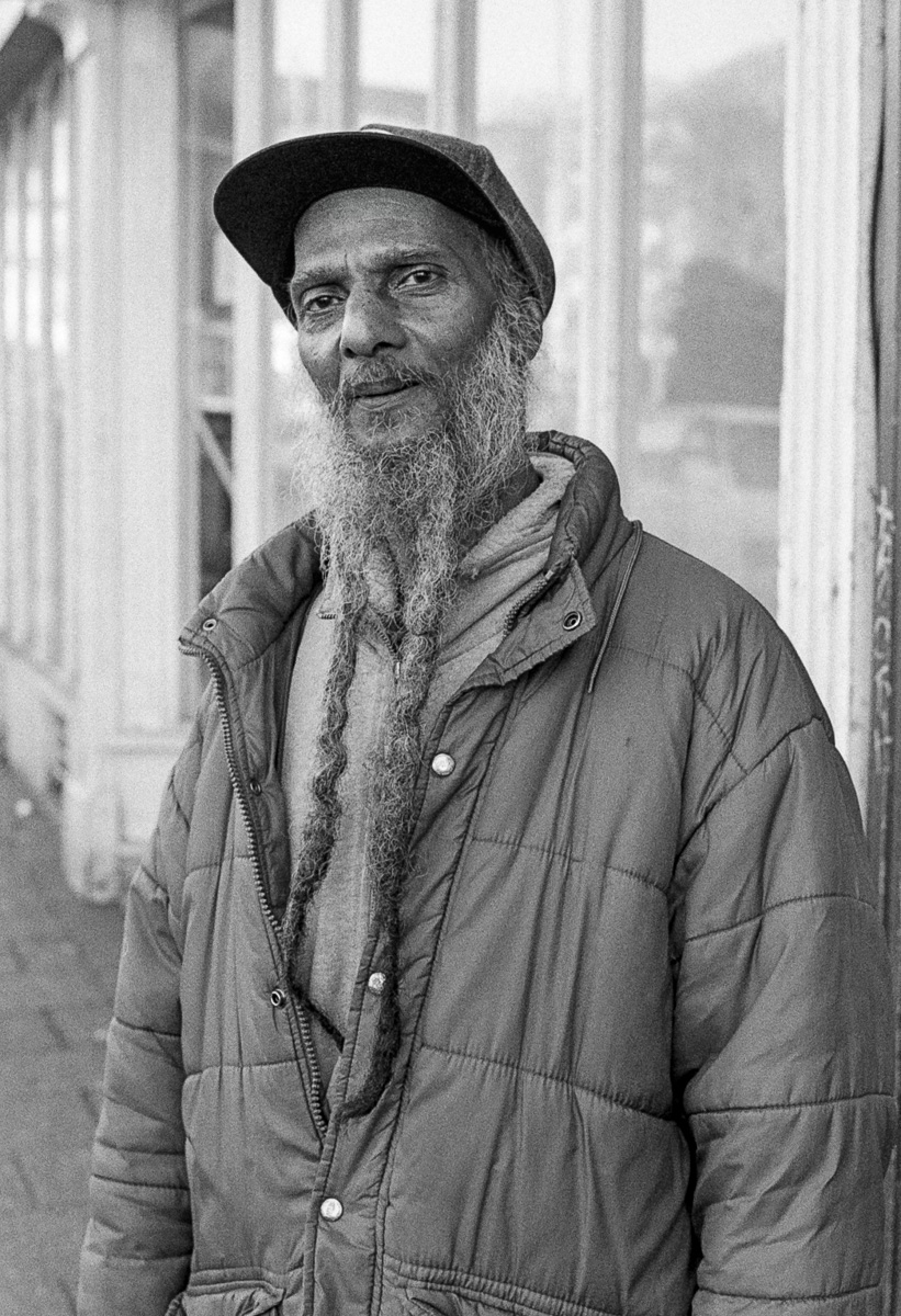 Street portrait of man with a beard with two plaits in St Paul's, Bristol.