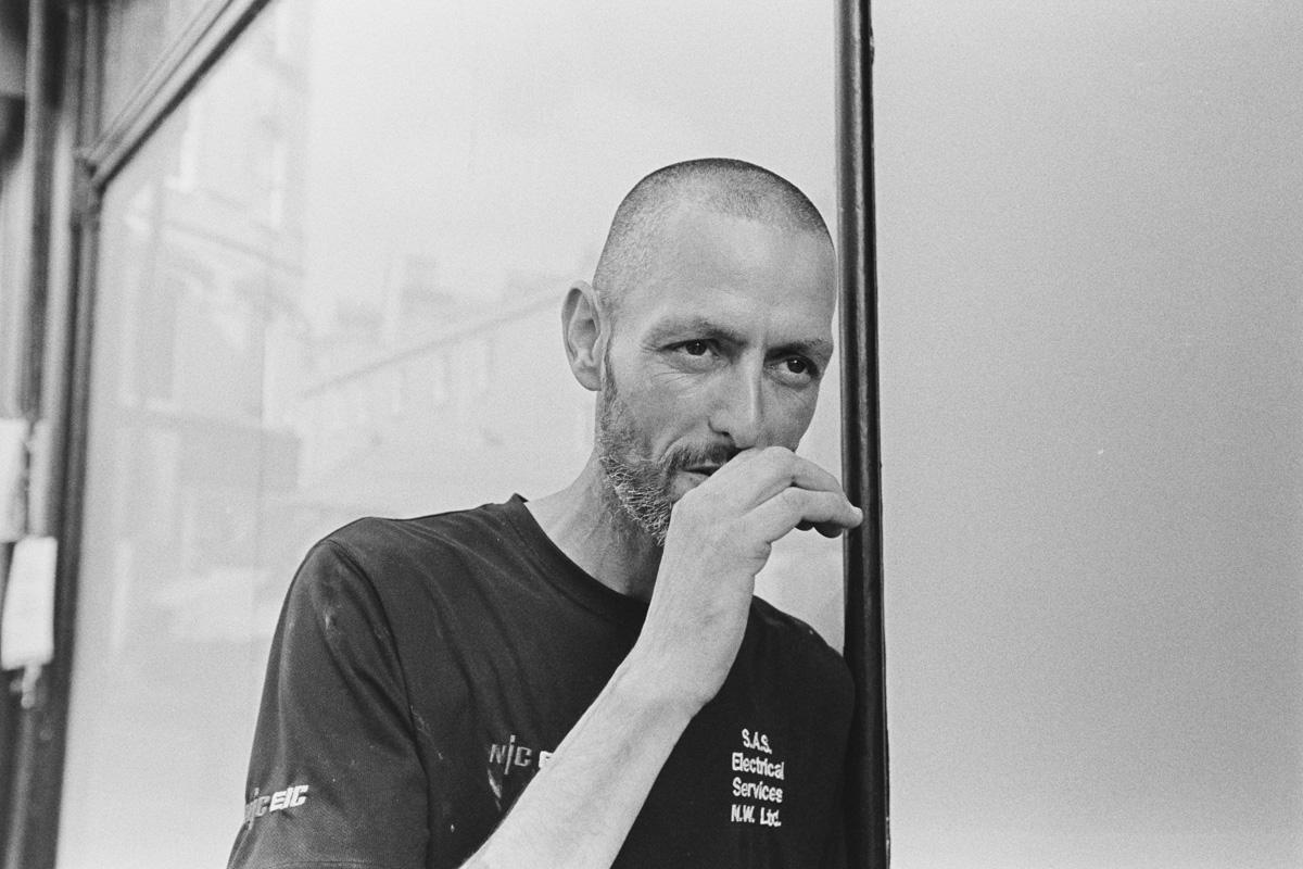 A shopfitter takes a cigarette break in Bath.