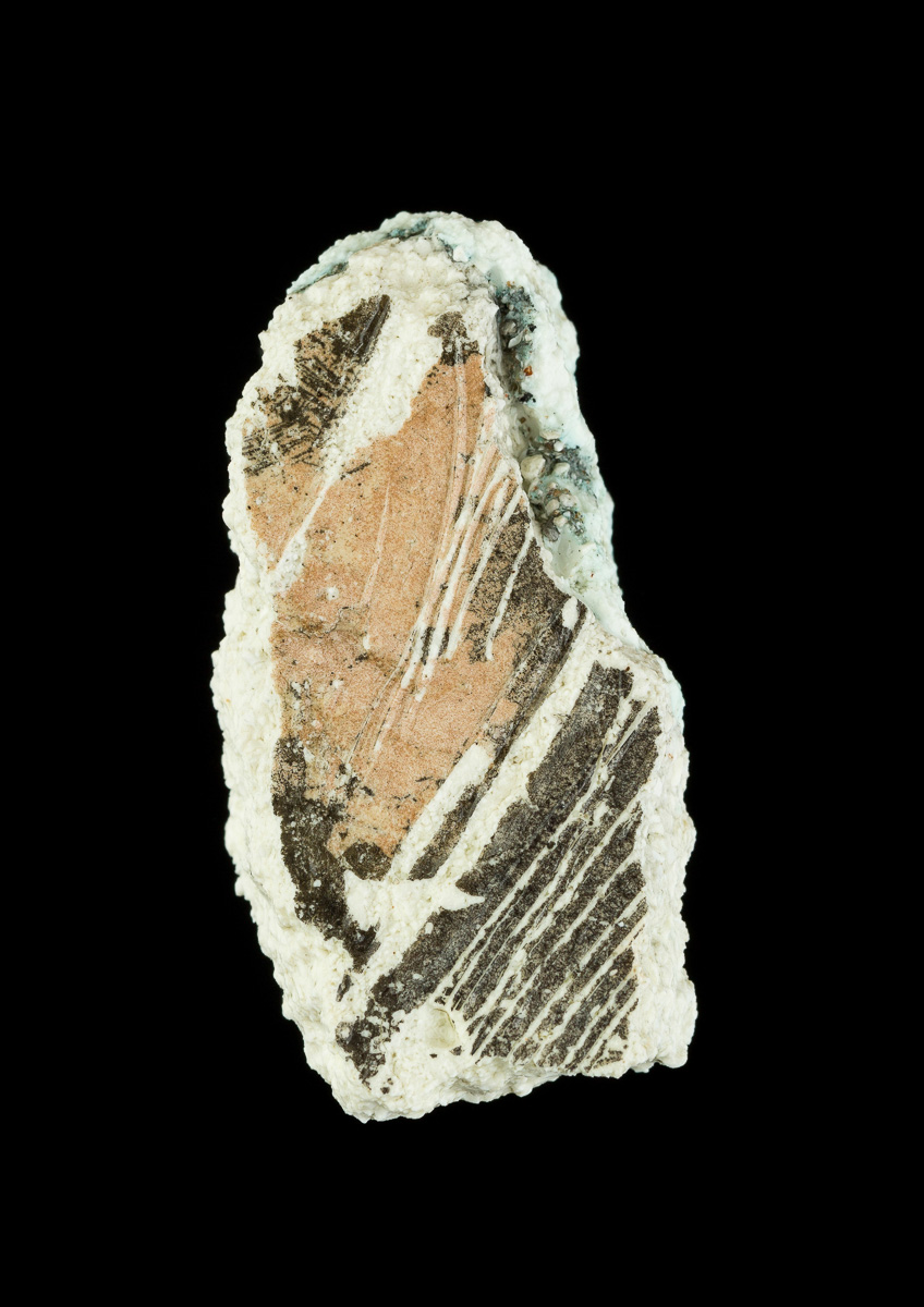 Striations and abstract bronze patterns in ceramic fragment.