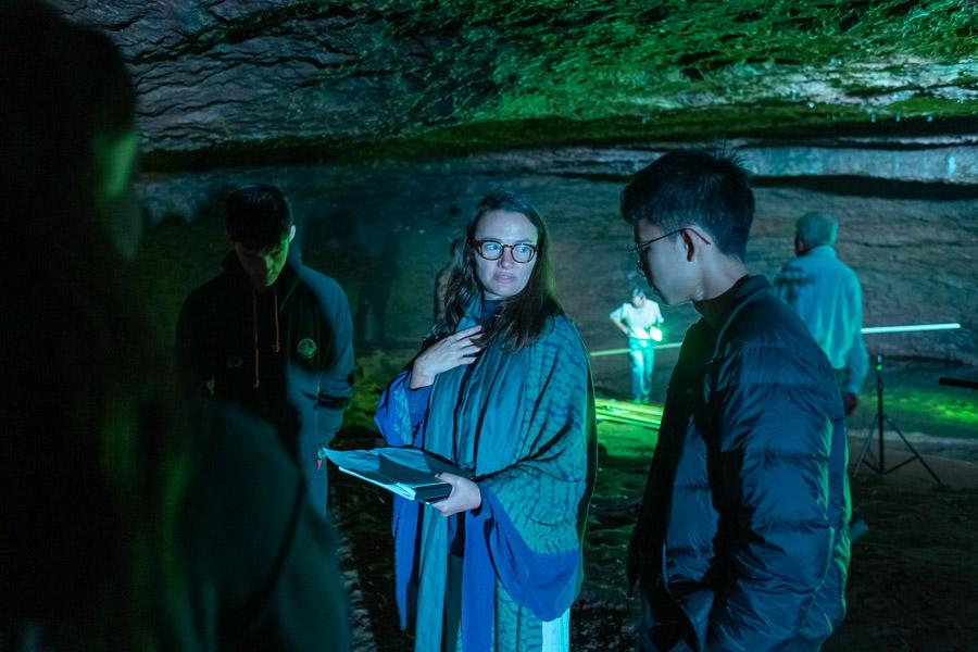 Musical director Christina Vantzou talks to choir members.