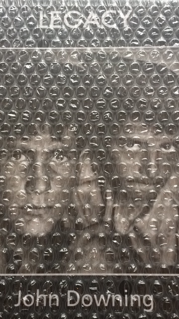John Downing's LEGACY book cover seen through the bubblewrap it arrived in.