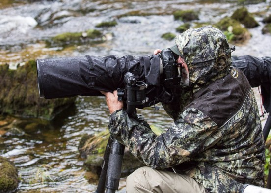 Rick Andrews photographing bears in the rain in the Great Bear Rainforest