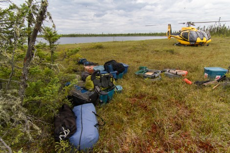 Unloading camp gear from a helicopter in Ontario's Far north muskeg