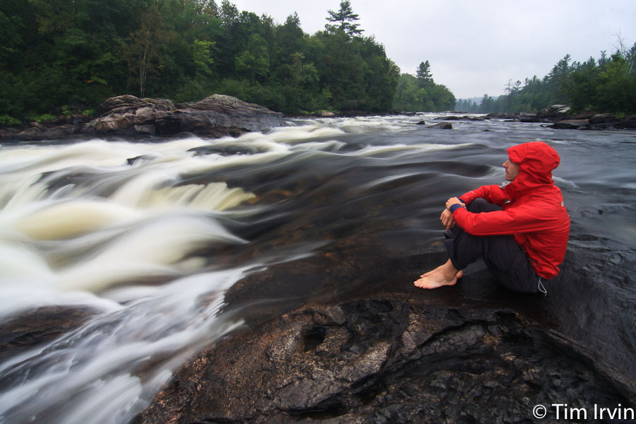 Sitting by a waterfall on the Coulonge River, Quebec