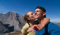 Two people get engaged on top of a mountain in the Yukon with a candy ring