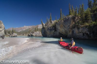 two canoers padding Snake River near milk Creek tributary, Yukon