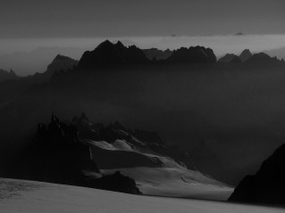 Early morning view over Col du Midi towards Verte and Droites from Dome du Gouter