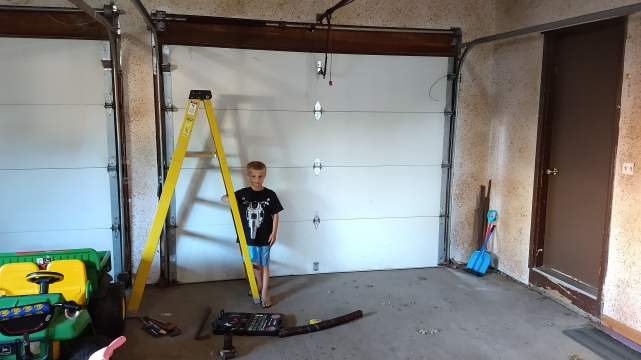 Working On A Bit of DIY Garage Door Repair