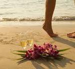 couple wedding beach flowers
