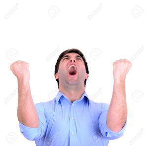 Successful man celebrating with arms up and shouting of joy isol