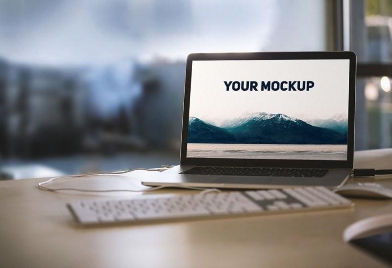 macbook on desk photo realistic mockup mockupworld