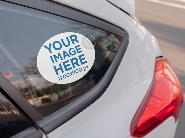 placeit mockup of an oval sticker on the quarter glass of a car