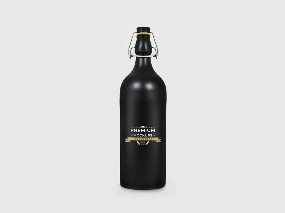 expensive black bottle mockup to showcase your creative logo brand