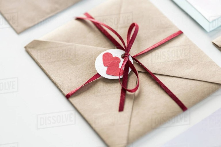 envelope with tag with two hearts and ribbon isolated on d211527215