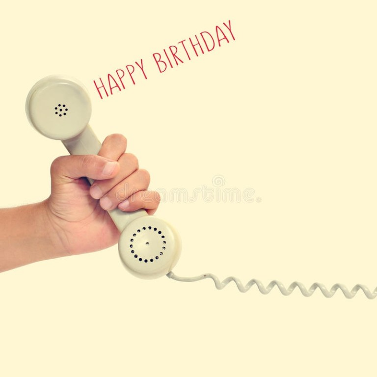 handset of a retro telephone and text happy birthday with