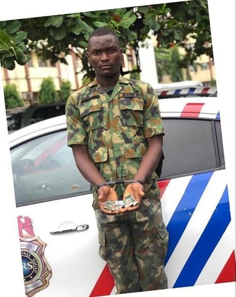 Yusuf standing infront of a police van .
