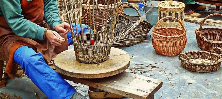 A basket maker, demonstrating his skills