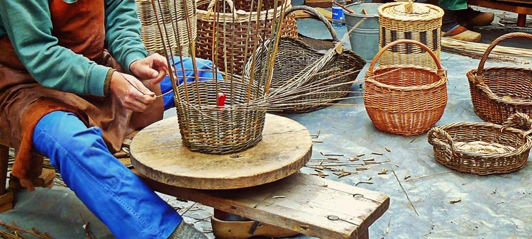 A basket maker, demonstrating his skills