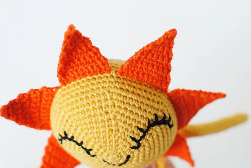 Amigurumi Sun doll shot up close to show how the Sun's rays are attached.