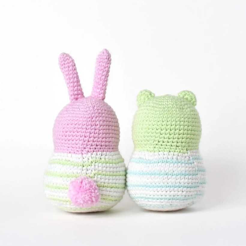Amigurumi Spring Bunny and amigurumi Bear behind view with pompom yarn Spring Bunny tail attached.