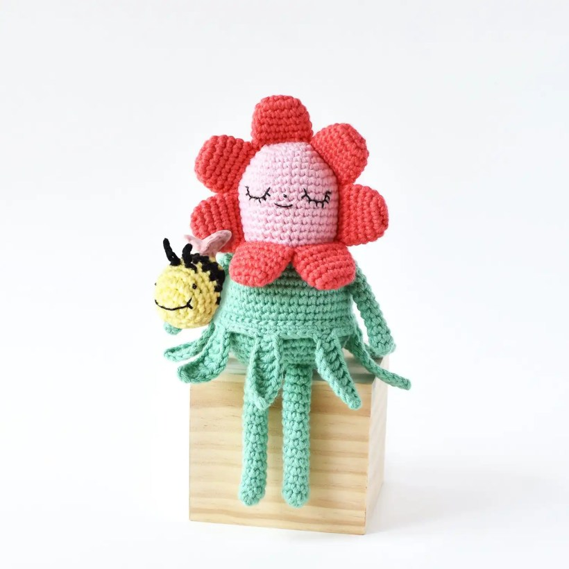 Picture shows finished product of the crochet flower pattern, Flower Gal & Bee Amigurumi by Tiny Curl.
