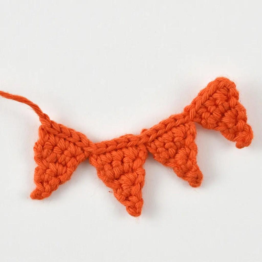 a crocheted chain of sun rays