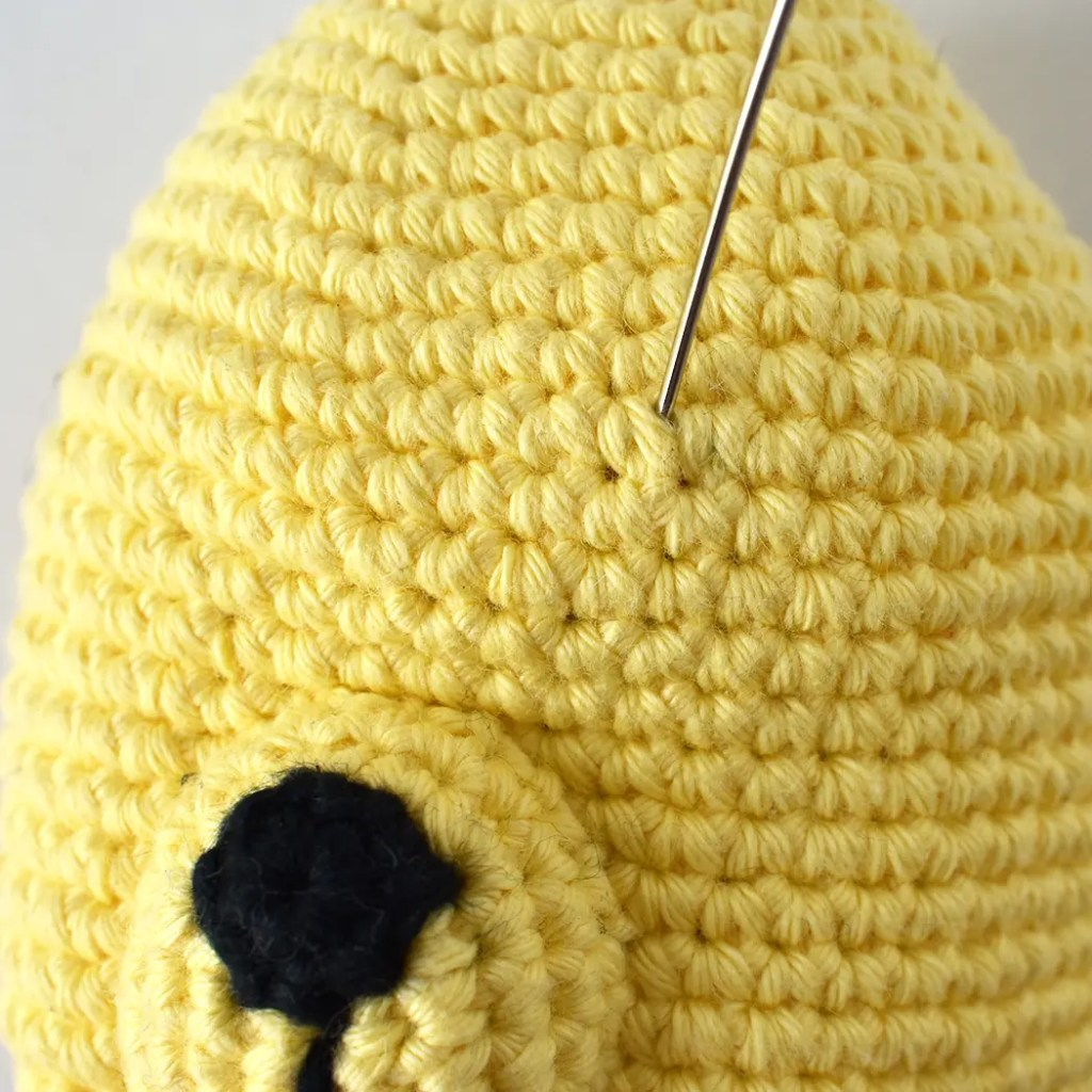 Close up of amigurumi face embroidery process for this free crochet pattern. Showing the amigurumi eye embroidery techniques used for this pattern.