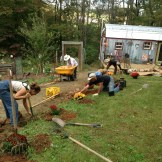 2013 Crop Mob at our house. Installed flower beds along pathway, sheet mulched the garden, double dug garden beds, weeded.
