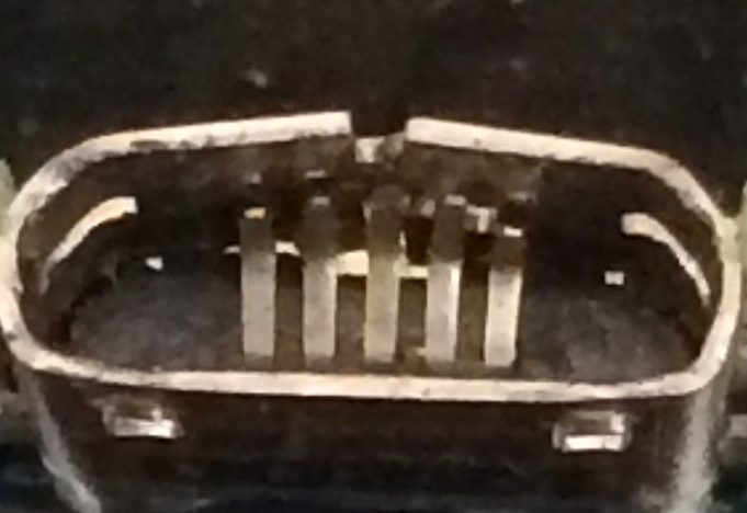 This image shows how the USB port pins can be damaged and bent