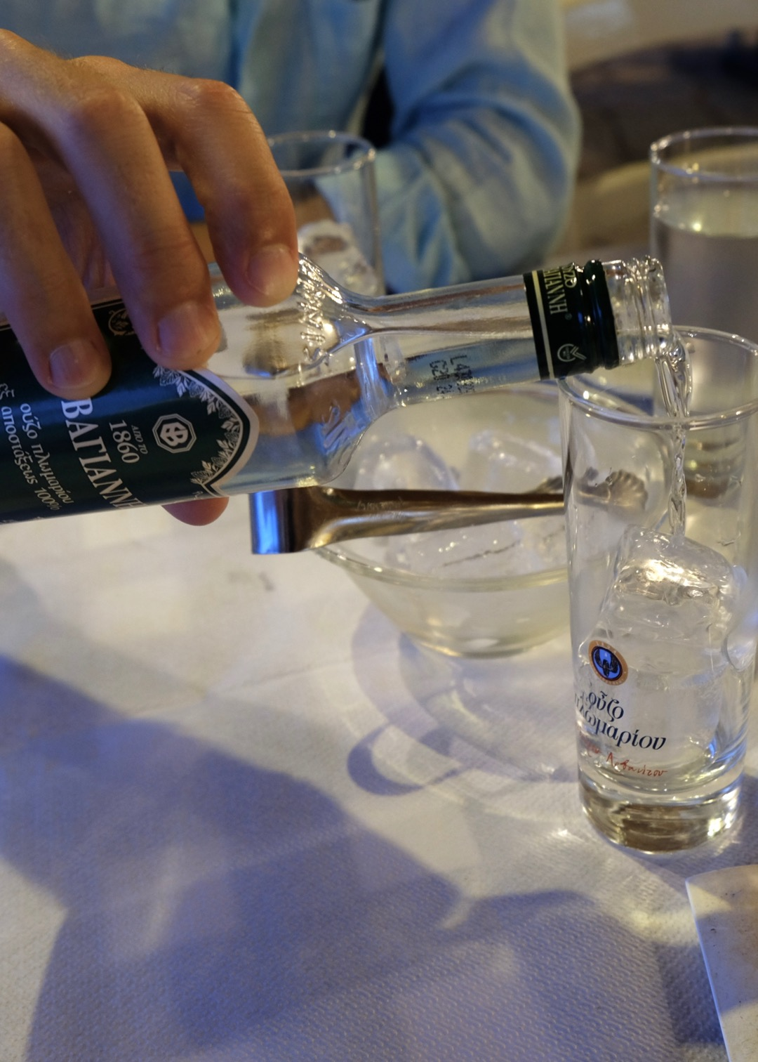 ouzo at a greek taverna in sithonia, greece