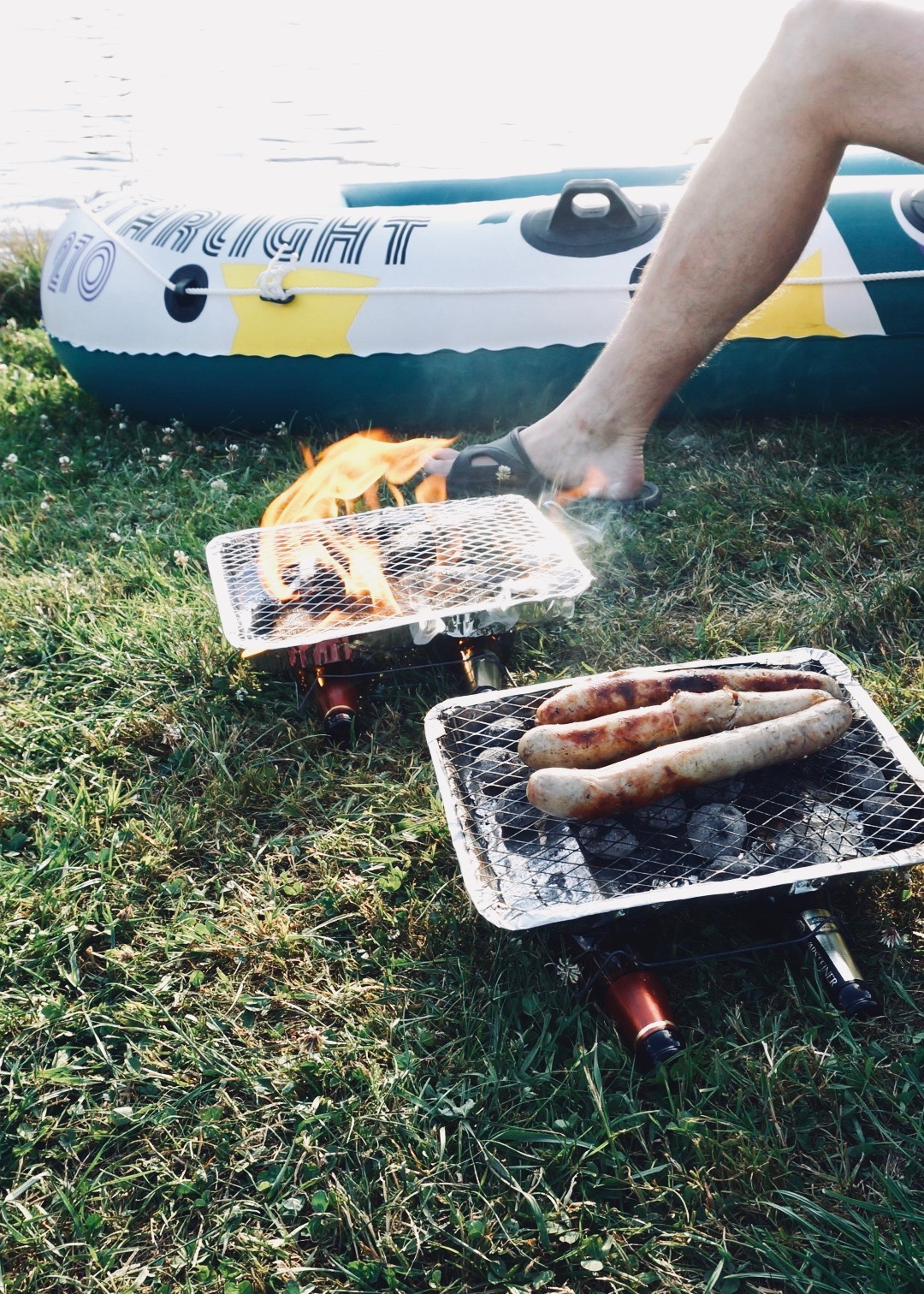 Camping and grilling using disposable grill at the lake in Germany