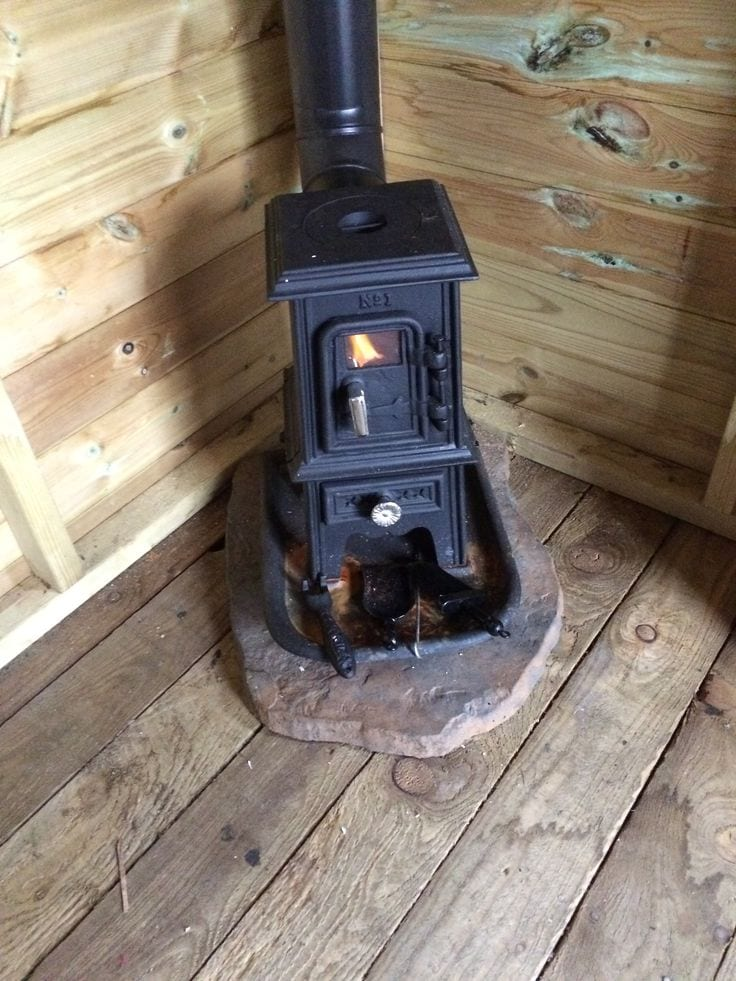 Small Wood Stove In Fireplace Kitchen