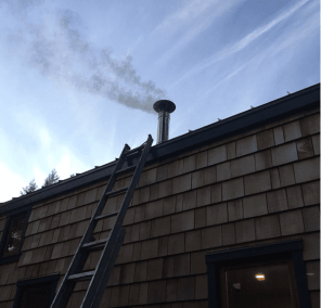 Tiny house and beautiful chimney smoke.