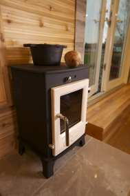 Dwarf stove with beautiful wood background.