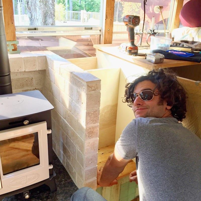 Ben finishing the wood storage nook.