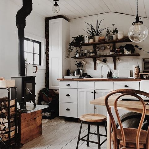 Wood stove in the kitchen/dining room.