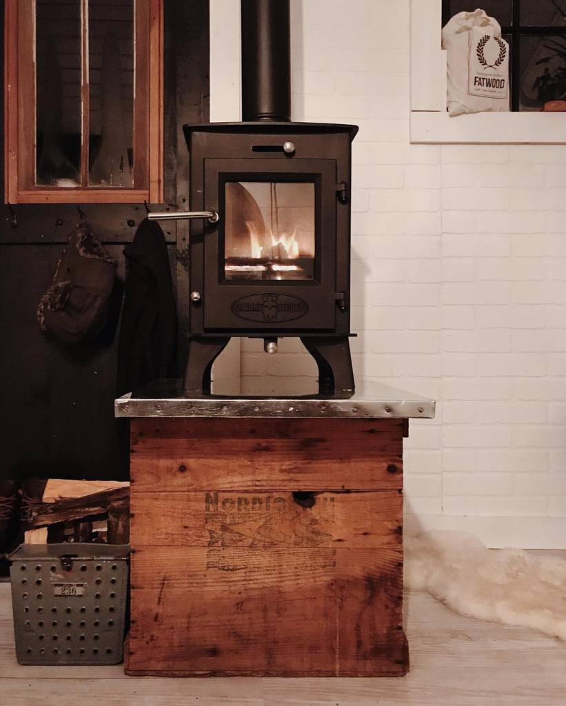 Tiny wood stove and custom stand.