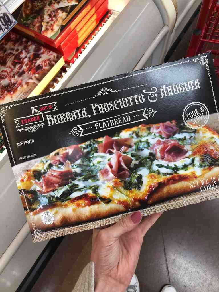 Burrata, prosciutto, and arugula pizza