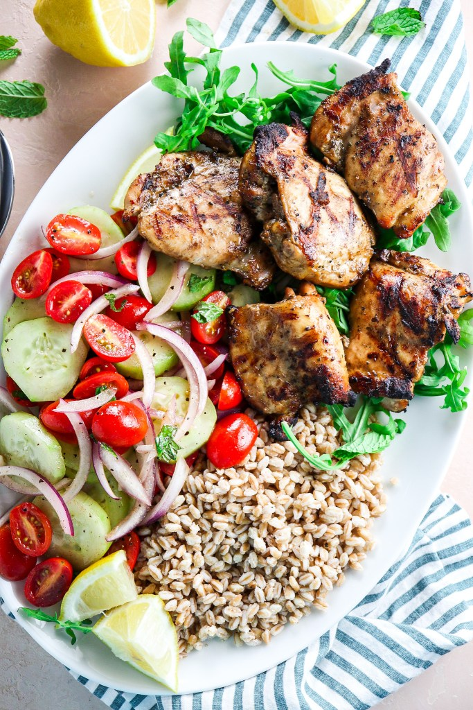 Grilled Chicken Thighs with Tomato-Cucumber Salad