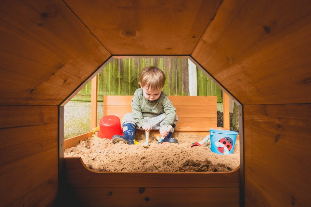 product review - choo choo train sandpit - boy through a tunnel