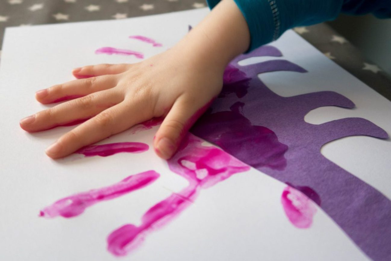 Dinosaur Crafts - making our dinosaur handprints