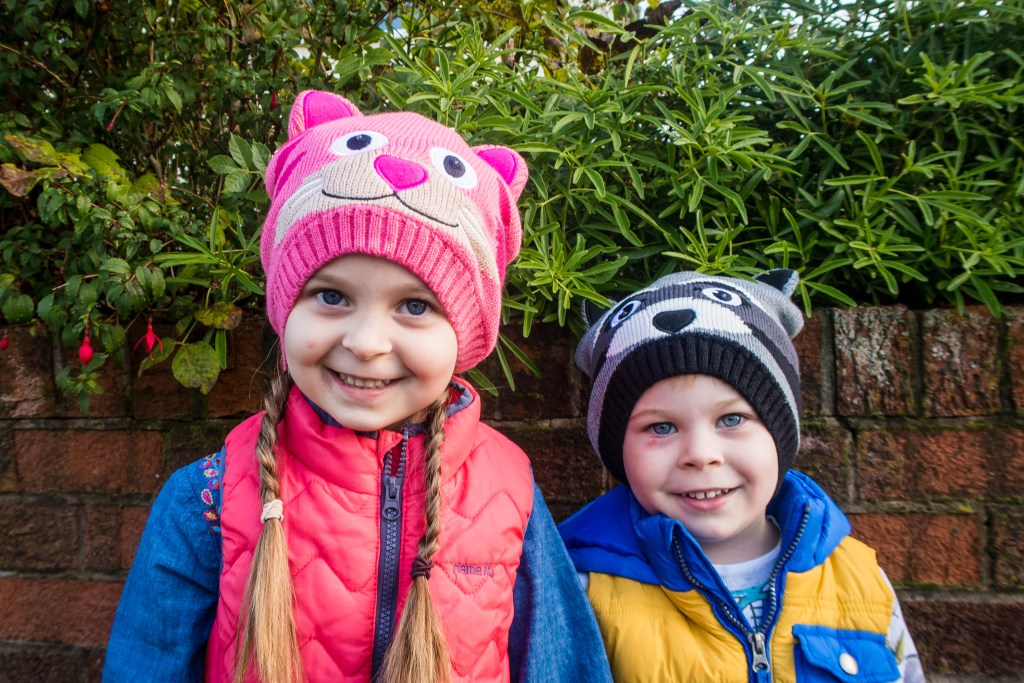 Two happy faces in their brighteyes children's hat