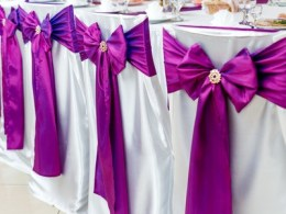 chairs decorated with ribbons for wedding
